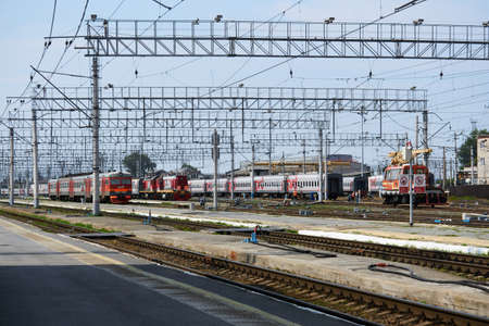 Perm, Russia - August 07, 2020: intercity and regional passenger trains on the tracks near the platforms of the railway station Redakční