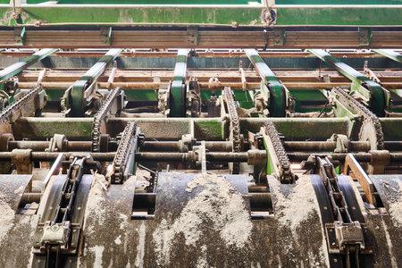 Feeder of a conveyor line of sawmill equipment inside a modern lumber mill