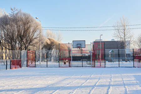 outdoor public basketball court on a frosty winter day