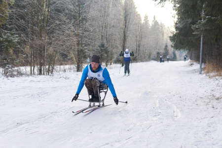 Perm, Russia - December 12, 2020: athlete with a disabilitiy participates in cross-country ski competition on a track in the forest