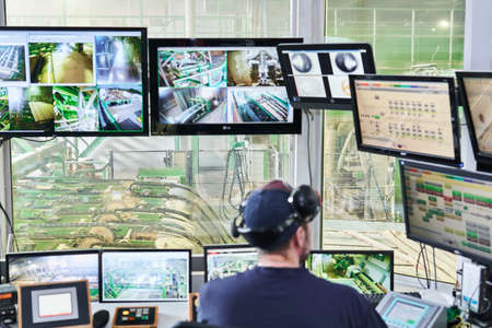 Perm, Russia - August 12, 2020: central point of remote control of a modern automated sawmill, focus on equipment outside the window