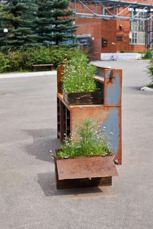 landscaping in rusty iron boxes on the territory of the factory turned into a public space