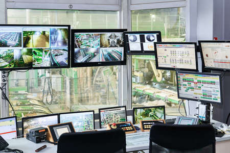 Perm, Russia - August 12, 2020: remote control room of a modern automated sawmill, focus on equipment outside the window