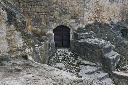 iron-lined gate to a medieval cave city-fortress 版權商用圖片