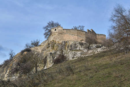 view of the ruins of a medieval fortress on a rocky hilltop
