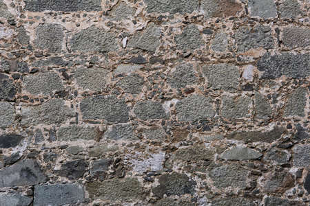 background, texture - ancient masonry at the wall of medieval palace Stock Photo
