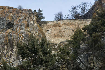 view of the ruins of a medieval ancient fortress wall between the rocks