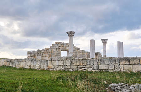 ruins of an ancient Greek basilika with columns against the sky 스톡 콘텐츠