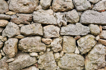 background, texture - ancient dry stone masonry (without mortar for binding stones) 스톡 콘텐츠