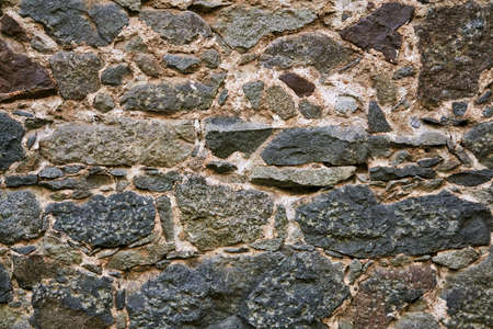 background, texture - ancient masonry at the wall of the fortress Archivio Fotografico