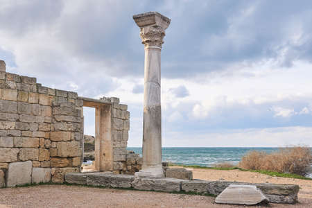 ruins of an ancient Greek temple with column by the sea shore