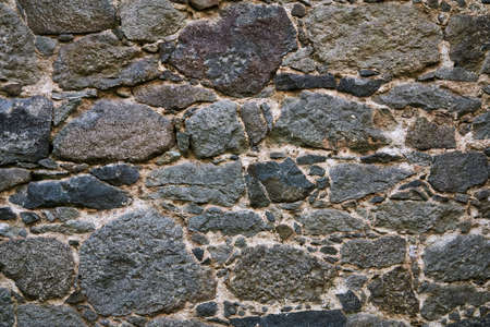 background, texture - ancient masonry at the wall of the fortress 스톡 콘텐츠