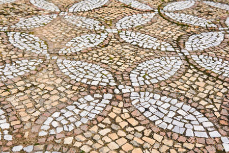antique mosaic pavement with a pattern of tiles outdoor 스톡 콘텐츠