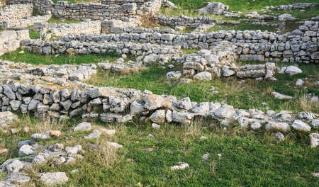 remains of walls and basements on the site of a destroyed ancient city 스톡 콘텐츠