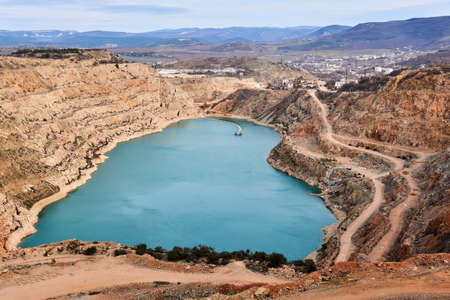 abandoned quarry with a heart-shaped lake at the bottom