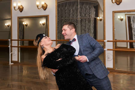 couple of amateur dancers dancing tango with each other and laughing