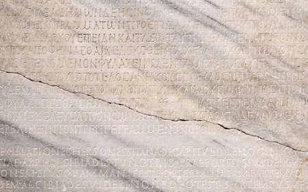 Sevastopol, Crimea - January 31, 2021: fragment of a marble slab with a carved text on the collection of taxes in ancient Greek from Chersonesos