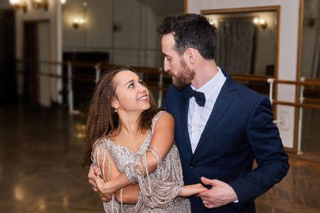 man and woman dancing classical partner dance