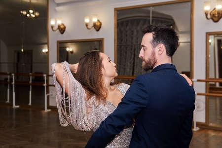adult couple dancing expressive partner dance in empty ballroom