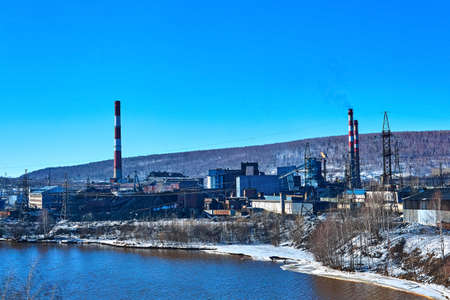 winter industrial landscape with an old coke-chemical plant in a valley on the river bank 版權商用圖片