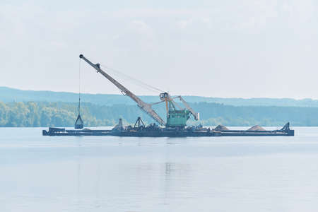dredger is working to deepen the fairway on the river