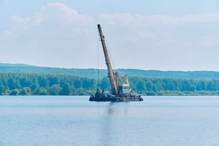 dredging boat is working to deepen the fairway on the river 版權商用圖片
