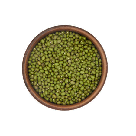mung beans in simple clay bowl isolated on white background, top view