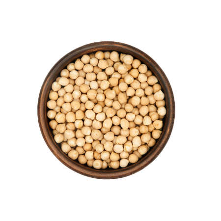 chickpea in simple clay bowl isolated on white background, top view