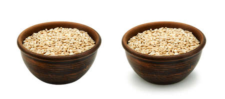 pearl barley in simple clay bowl on white background, isolated and with shadow