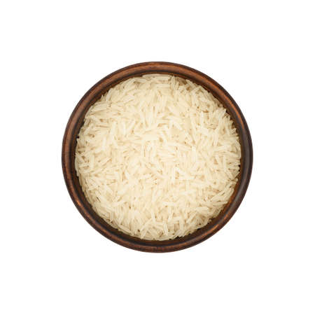 white rice in simple clay bowl isolated on white background, top view