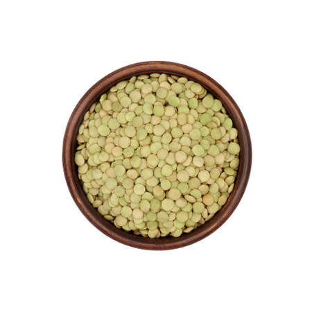 green lentils in simple clay bowl isolated on white background, top view Archivio Fotografico