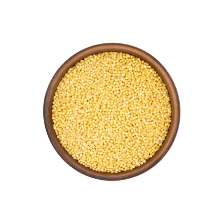 red millet in simple clay bowl isolated on white background, top view