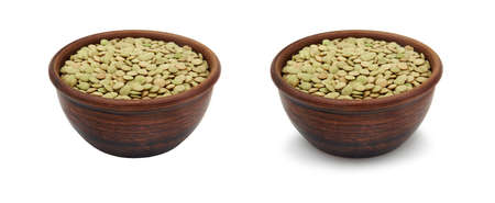 green lentils in simple clay bowl on white background, isolated and with shadow
