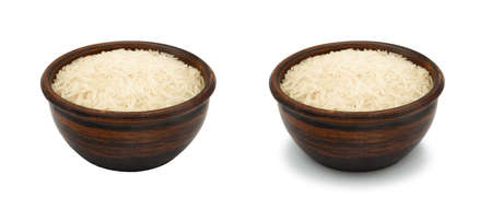 white rice in simple clay bowl on white background, isolated and with shadow