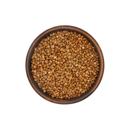 buckwheat grain in simple clay bowl isolated on white background, top view