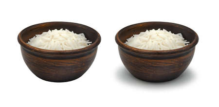 boiled white rice in simple clay bowl on white background, isolated and with shadow Archivio Fotografico