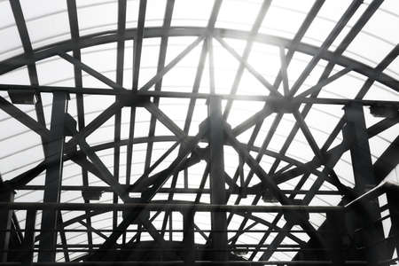 sun shines through the lattice structures of the covered pedestrian overpass Archivio Fotografico