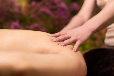 hands of a professional masseuse while working close up