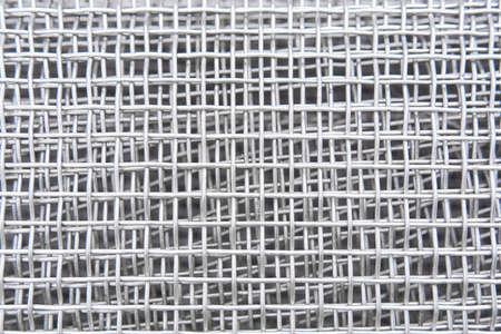 abstract industrial background - roll of galvanized metal mesh close up