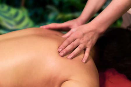 female manual therapist`s hands during work close-up