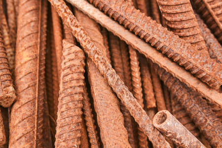 rusty reinforcing bars piled in a heap close-up Archivio Fotografico