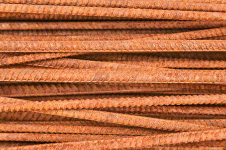 background - pieces of rusty rebar piled in a heap close-up