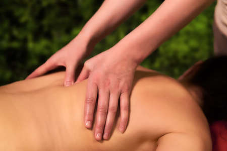 hands of a professional masseuse while working close-up