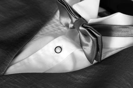jacket with white shirt and bow tie