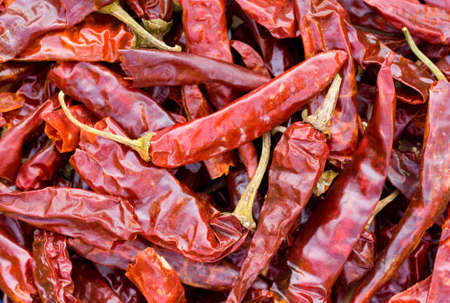 Dried chilli peppers background Stock Photo