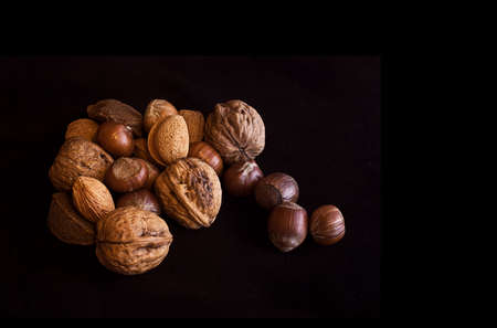 Variety of nuts isolated on a black background photo
