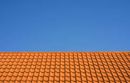 Ceramic tile roof against a blue sky