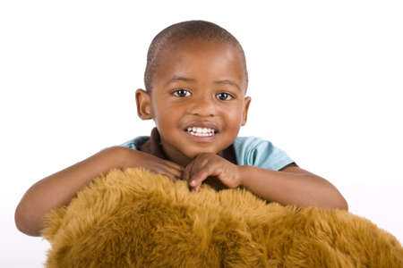 3 year old: Adorable 3 year old black or African American boy with a toy bear smiling very happily