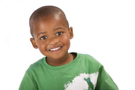 Cute happy 3 year old black or African American boy smiling for the camera
