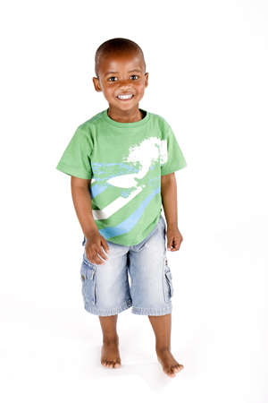 Three year old black or african american boy standing upright smiling happily Stock Photo